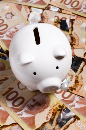 canadian currency: Piggy Bank and Canadian dollar, concept of Finance Stock Photo
