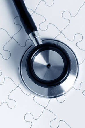 Stethoscope and puzzle, concept of Solution