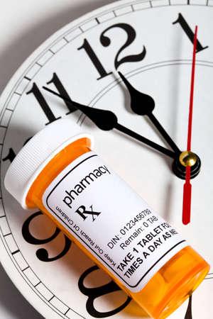 Clock and Pill Bottle, concept for Healthcare And Medicine Reklamní fotografie