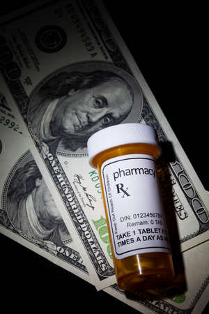 dollar and Pill Bottle, concept for Healthcare And Medicine photo