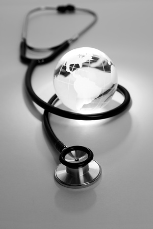 Stethoscope and Globe, concept of World Problems photo