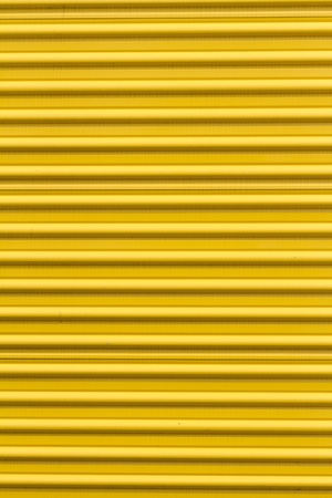 corrugated steel: Yellow paint Corrugated Metal for textured background