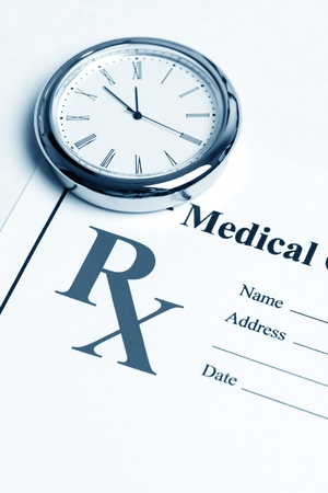 Clock and Prescription, concept for Healthcare And Medicine Stock Photo