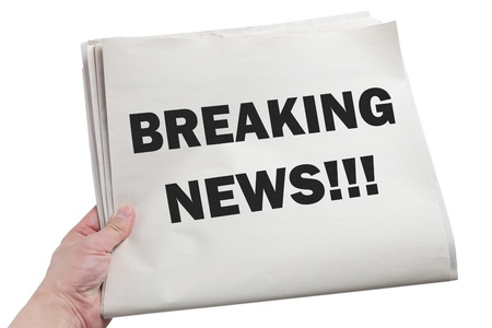 Hand hold Breaking News with white background Stock Photo - 13366899