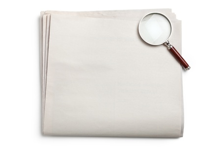 Blank Newspaper and magnifying glass with white background photo