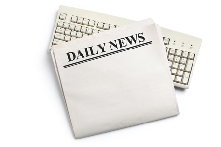 Daily News, Computer Keyboard and Newspaper with white background photo