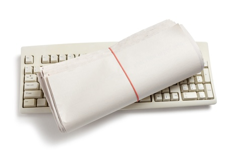 Computer Keyboard and Newspaper roll with white background Stock Photo - 13357206