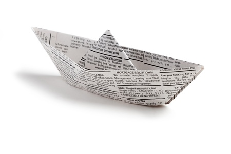paper boat: Fake Newspaper boat, business concept
