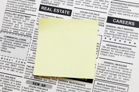 Fake Classified Ad, newspaper and sticky note Stock Photo - 14055690