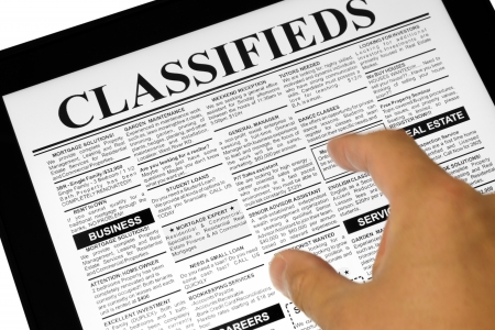 Fake Classified Ad, newspaper and Touch Screen, business concept. photo