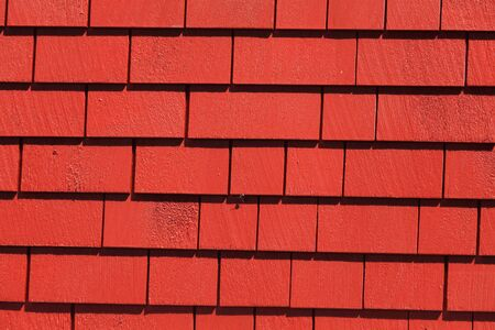 Red Wooden tiles wall for background Banco de Imagens