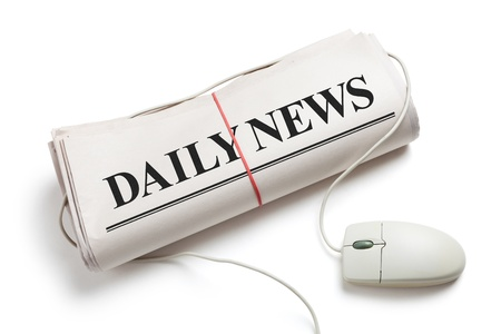 Computer mouse and Newspaper Roll with white background Stock Photo - 14577897