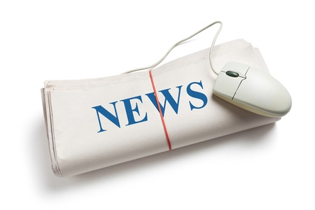 Computer mouse and Newspaper Roll with white background photo