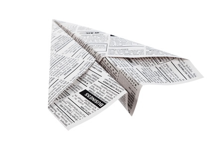 Newspaper Airplane, Classified Ad, business concept. photo