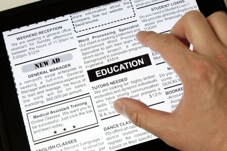 classified ad: Fake Classified Ad, newspaper and Touch Screen, Education concept. Stock Photo