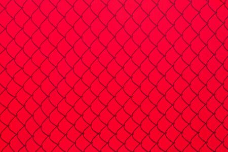 Chainlink Fence Shadow on red Shade Cloth Stock Photo - 15330527