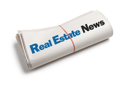 Real Estate News, Newspaper roll with white background photo
