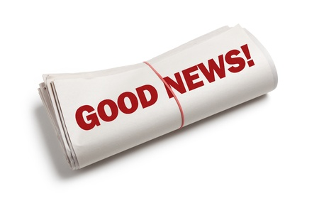 Goed nieuws, krant rol met een witte achtergrond