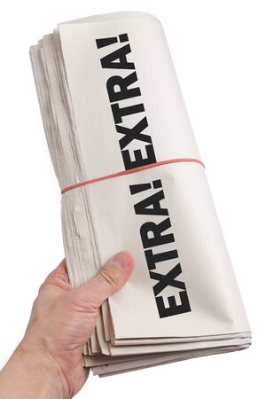 Newspaper roll Extra with white background photo