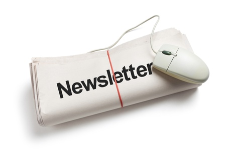 Newsletter and Computer mouse with white background photo