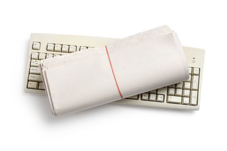 Computer Keyboard and Newspaper roll with white background photo