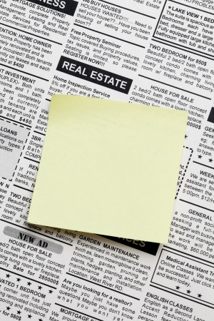 Fake Classified Ad, newspaper and sticky note photo