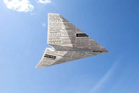 classifieds: Fake Newspaper Airplane, Classified Ad, business concept.