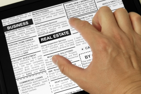 classifieds: Fake Classified Ad, newspaper and Touch Screen, Real estate concept. Stock Photo