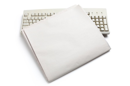 blank newspaper: Computer Keyboard and Newspaper with white background Stock Photo
