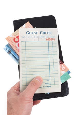 Blank Guest Check and dollar, concept of restaurant expense. photo
