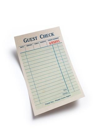 cheque en blanco: Check Invitado blanco, concepto de gasto restaurante.