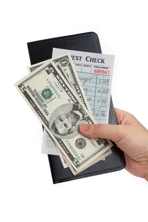 pay bills: Guest Check and dollar, concept of restaurant expense.