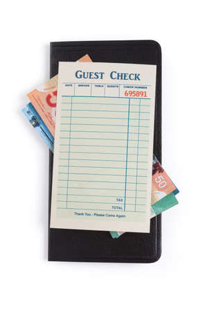 canadian currency: Blank Guest Check and dollar, concept of restaurant expense.