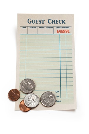 Blank Guest Check and Coin, concept of restaurant tip. photo