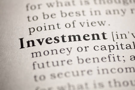 Fake Dictionary, Dictionary definition of the word Investment. Stock Photo