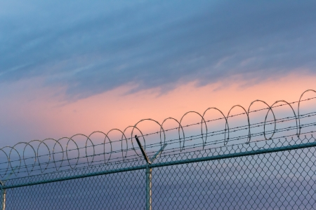 barbed wire fence and sky Stock Photo