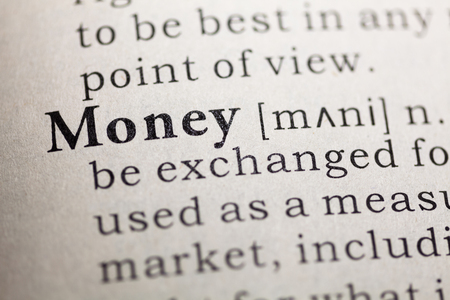 Dictionary definition of the word money.  Stock Photo