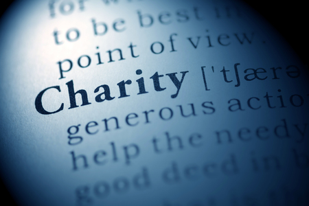 printing out: Fake Dictionary, Dictionary definition of the word charity. Stock Photo