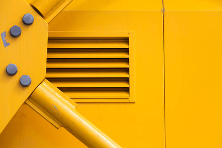 Yellow Metal Machine Part for background Stock Photo