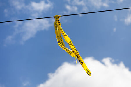 caution tape with blue sky photo