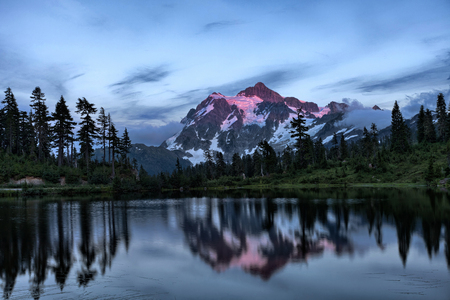 Mt Shuksan with Picture Lake in foreground in Washington state photo