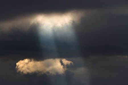 sun shining through the clouds photo