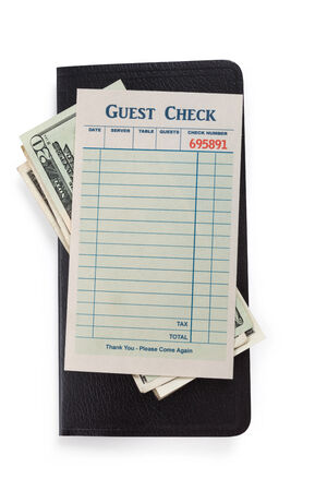 Blank Guest Check and dollar, concept of restaurant expense  photo