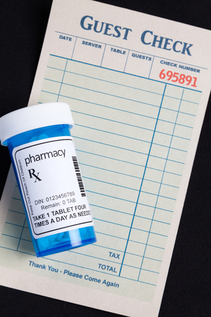interactions: Guest Check and Pill Bottle, concept of avoid Food and Drug Interactions  Stock Photo