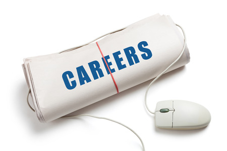 Careers, Computer mouse and Newspaper Roll with white background photo