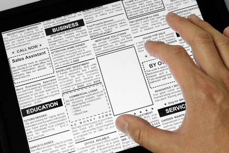 classifieds: Fake Classified Ad, newspaper and Touch Screen, business concept  Stock Photo
