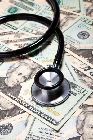 medical bill: Stethoscope and dollar, concept of Financial Health Stock Photo