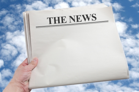 blank newspaper: Hand holding a Blank Newspaper