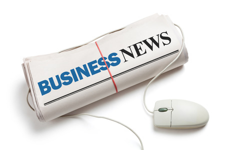 Business News, Computer mouse and Newspaper Roll with white background photo