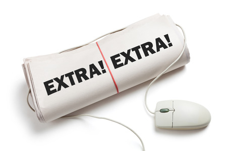 News Extra, Computer mouse and Newspaper Roll with white background photo